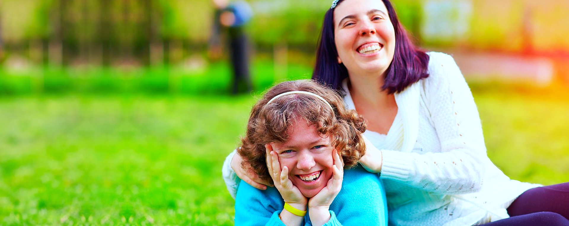 girl with autism with her caregiver